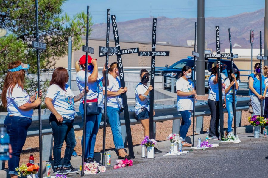 Cross bearers stand by at the Cielo Vista Walmart memorial  honoring the victims of last years mass shooting Aug. 3, 2020.