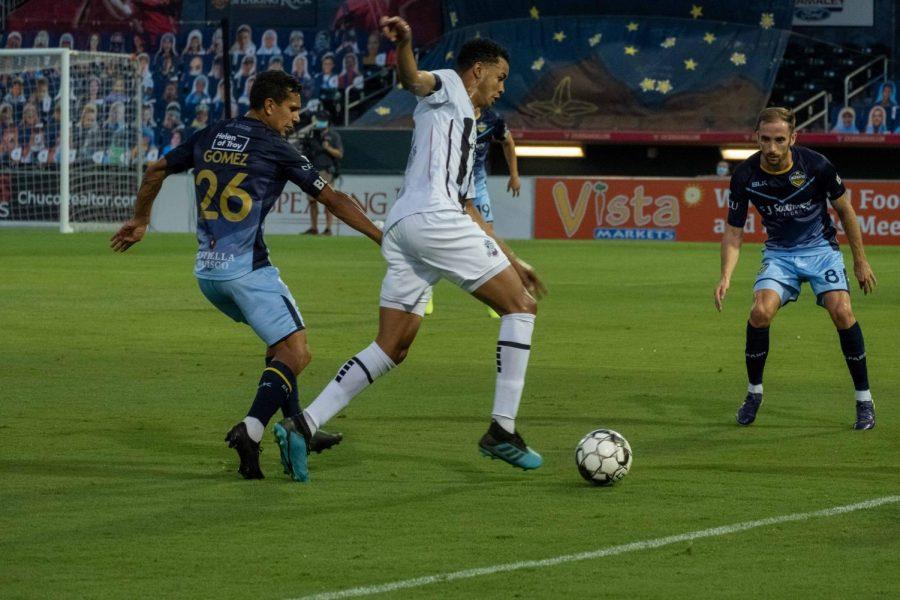Locomotive forward Jose Aaron Gomez and midfielder Nick Ross pressure Colorado forward Saturday Aug. 8, 2020.