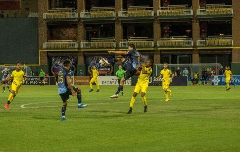 El Paso Locomotive forward Omar Salgado goes up for a high kick  over a defender versus New Mexico United July 15, 2020