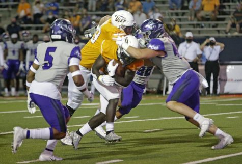 UTEP senior running back Josh Fields scores on a 5-yard touchdown run versus Abilene Christian Saturday Sept. 20.