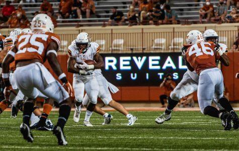 UTEP freshman running back Deion Hankins looks for running room versus Texas Longhorns Saturday Sept. 12.