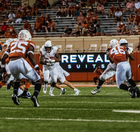 UTEP freshman running back Deion Hankins looks for running room versus Texas Longhorns Saturday Sept. 12.