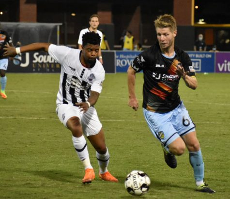 El Paso Locomotive Midfielder Richie Ryan runs against a member of Colorado Springs Swtichbacks at Southwest University Park, Wednesday, Sept.  16.
