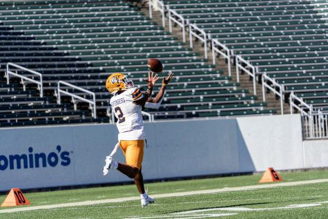 UTEP senior wide receiver Justin Garret reels in a pass in pregame warmups versus Charlotte Oct 24.