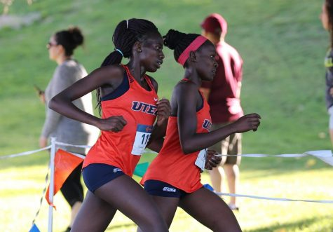 UTEP senior Caroline Chepkosegei  runs alongside former teammate Linda Cheruiyot at Lori Fitzgerald Classic at Chamizal Park in El Paso Sept. 13, 2019.