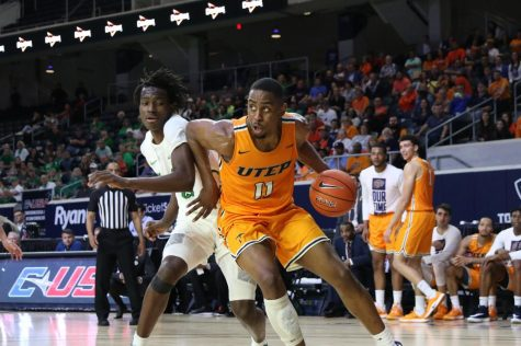 UTEP forward Bryson Williams pushes off defender as he looks for the score versus Marshall Feb. 15.