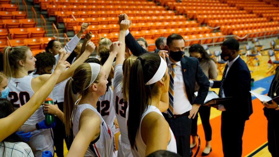 UTEP coach Kevin Baker motivates the women's basketball team as they take the court against New Mexico State Nov. 25.