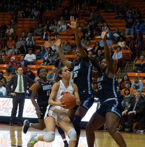 UTEP point guard Katia Gallegos drives to the basket drawing two Monarch players to defend her versus Old Dominion Feb 8.