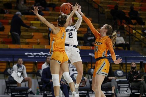 UTEP sophomores Katia Gallegos and Crouse double team Utah State guard Meagan Mendazona in Logan , Utah Dec. 13.