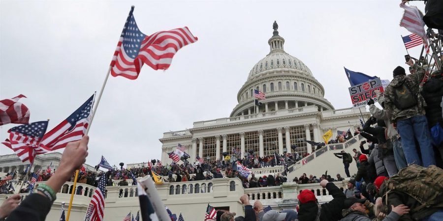 A mob of supporters of President Donald Trump storm the U.S. Capitol on Jan. 6.