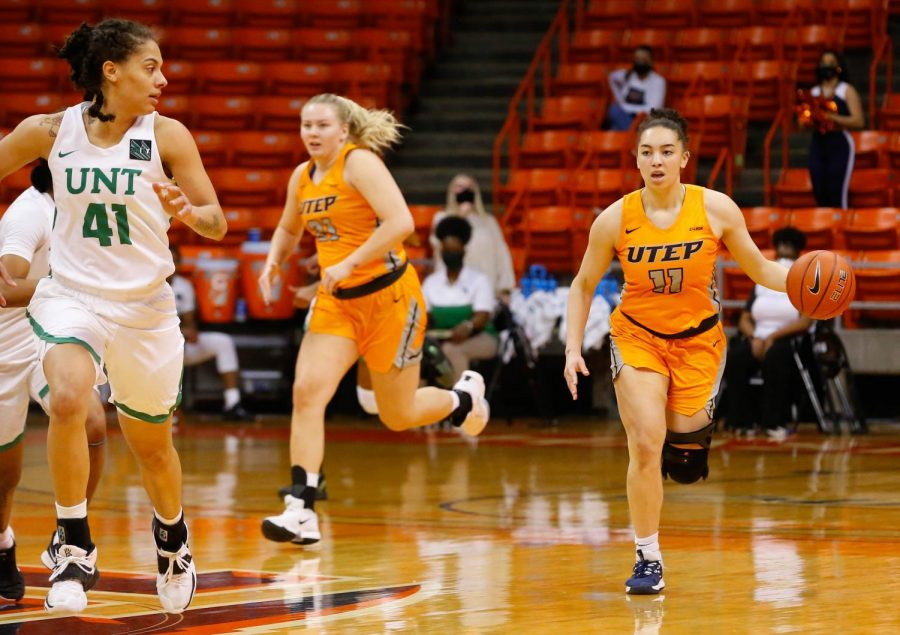 UTEP sophomore guard Isis Lopes brings the ball up the court for the Miners in a 62-52 win over North Texas Jan. 16.