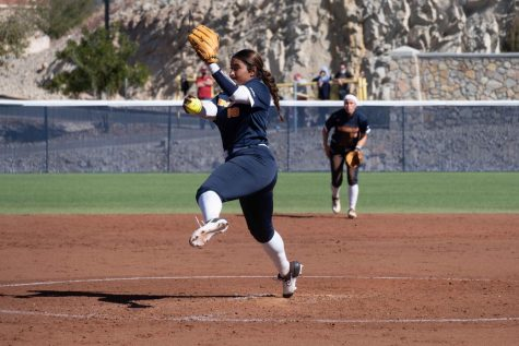 Freshman pitcher Victoria Salazar throws the first pitch of the season for the UTEP Miners in a matchup with fourth ranked Oklahoma Feb. 11.