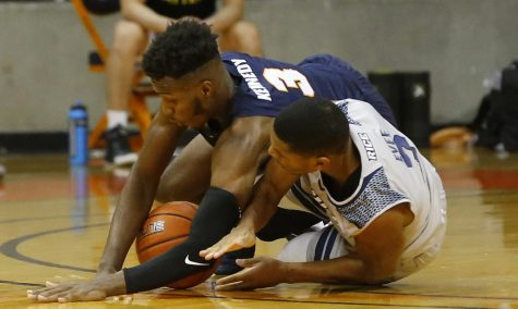 UTEP sophomore guard Keonte Kennedy  fights for a loose ball against the Rice Owls. Jan 8.