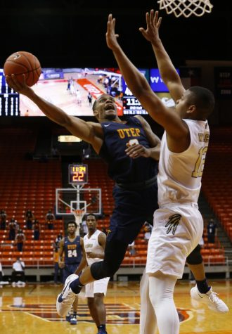 UTEP junior guard Christian Agnew drives hard to the basket versus Florida International drawing a foul Feb. 13.