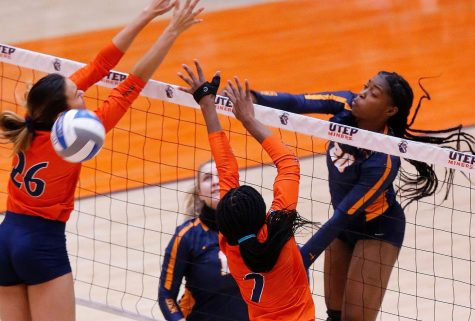 Junior Serena Patterson spikes the ball over the net for a kill against UTSA  Feb. 23.