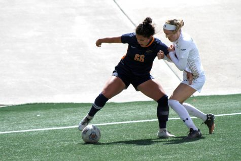 UTEP sophomore forward Tessa Carlin fights off a UAB defender near Blazer goal March 14.