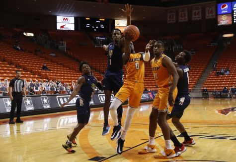 UTEP junior guard Souley Boum drives to the basket in traffic versus Florida International, Feb. 13.