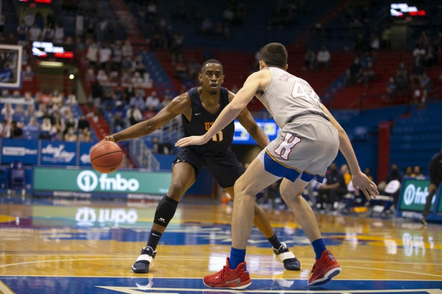 Senior Bryson Williams tries to work past a Kansas defender March 4.