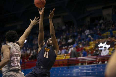Senior forward Bryson Williams shoots a fade-away jumper over Kansas