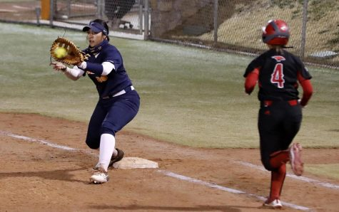UTEP first baseman, Arianna Valles receives a throw for a put-out of a Texas Tech batter March 20 in Lubbock, Texas.