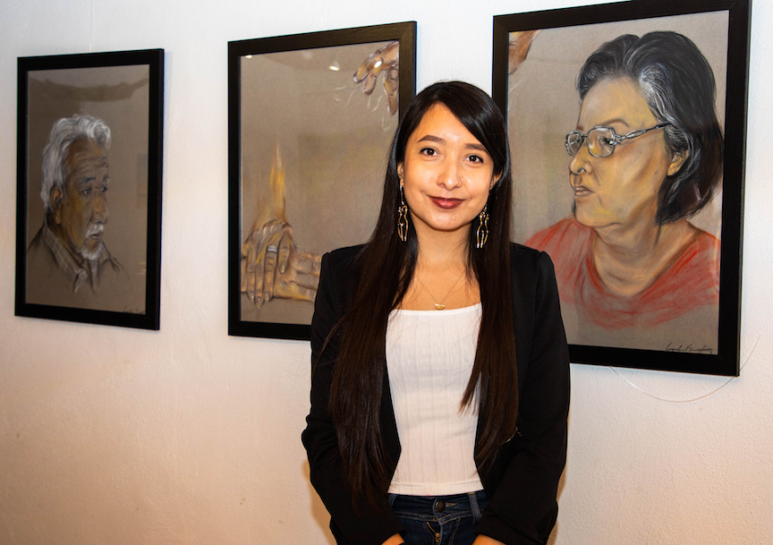Jaqueline Martinez stands in front of her art work featured at Casa Ortiz's Last Thursdays event on Feb. 25, 2021.