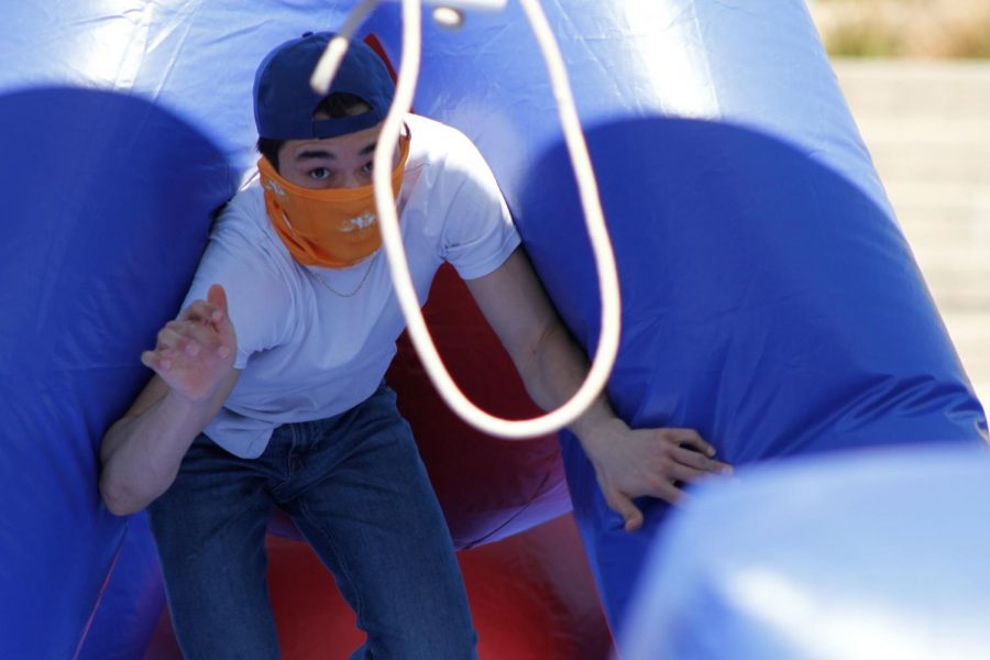 Fernando Rivera comes out from an obstacle game ready to jump over the swing at Centennial Plaza on March 30, 2021, as part of UTEP's in-person Field Day.