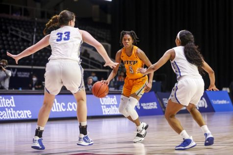 Junior guard Destiny Thurman  looks for an opening with two Blue Raider defenders closing down the down in a loss to MTSU March 12.
