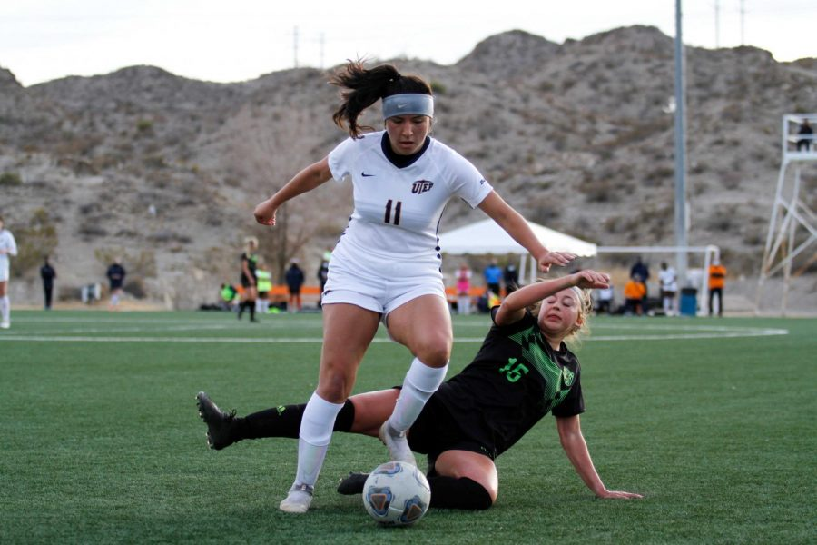 UTEP sophomore  midfielder Vanessa  Cabello fights off charge  from a Utah Valley defender as she moves downfield Feb. 13.