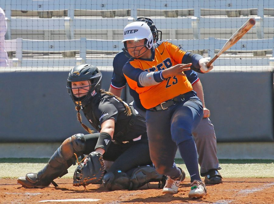 UTEP  sophomore  third  baseman  Kasey  Flores  looks  on  as  she  makes  contact  with a pitch versus Southern Miss April 2.