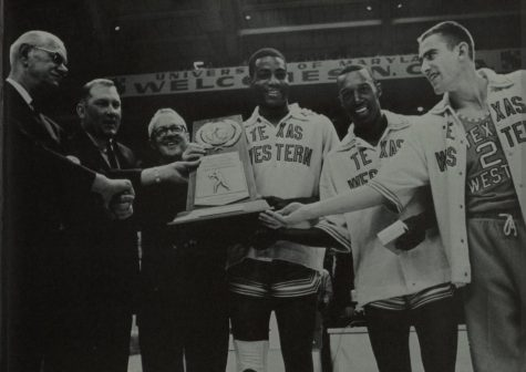 Members of the 1966 Texas Western national championship team accept the championship trophy.