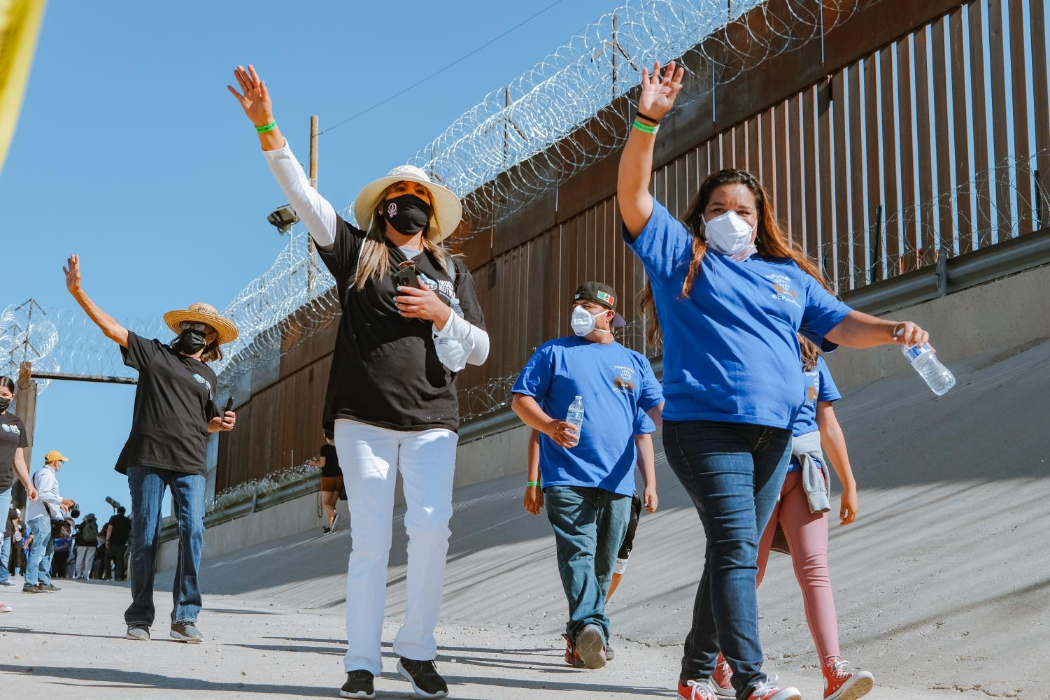 Families+separated+by+U.S.-Mexican+border+reunite+for+three+minutes+at+%E2%80%98Hugs%2C+Not+Walls%E2%80%99