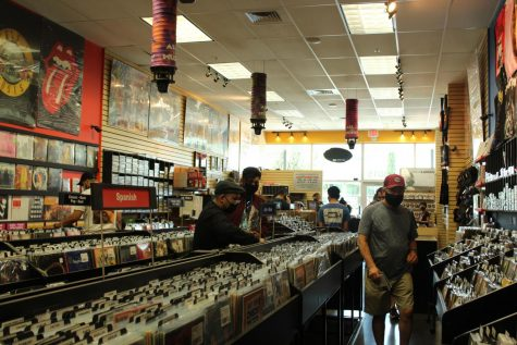 The store features records and CDs of various genres, including Classic Rock, Jazz and Blues, R&B, Indie, and more.
