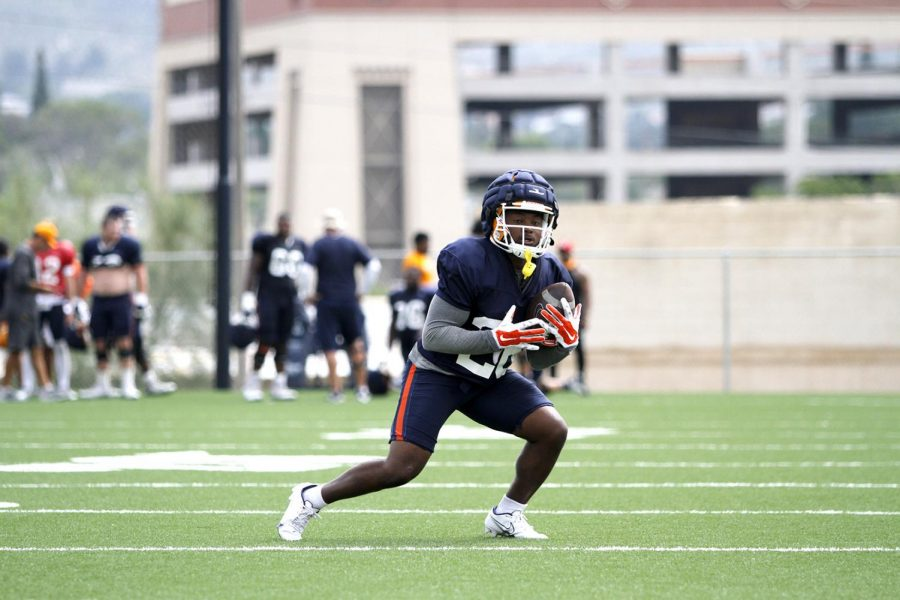 Walter Dawn Jr. catches a punt kick during practice on August 16, 2021