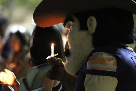 Paydirt Pete lights a candle in honor of President Emerita Dr. Natalicio at the Celebration of Life for President Emerita Diana Natalicio on Sunday, Oct. 24, at Centennial Plaza on the UTEP campus.