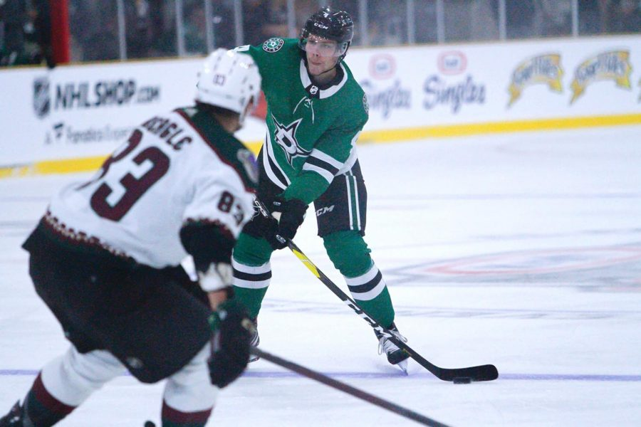 Jacob Peterson, a Center for the Dallas Stars makes a pass against the Arizona Coyotes on October 3, 2021
