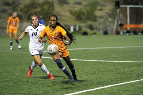 UTEP forward Kam Fisher prepares to pass the ball to a teammate against a UTSA opponent