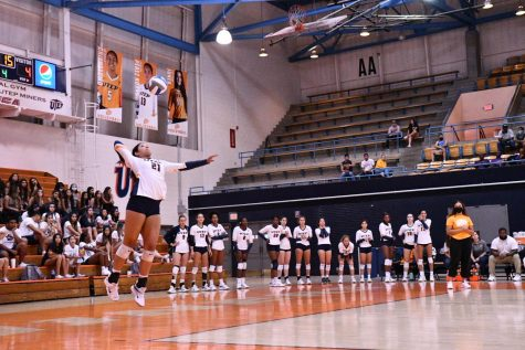 Freshman setter Ryley Frye serves the ball at Memorial Gym during a match.  Photo credit: Ace Acosta